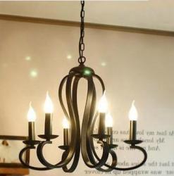 Кованая люстра в виде свечей